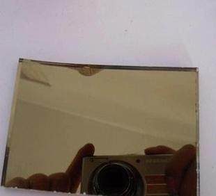 Automotive grade brown coated glass